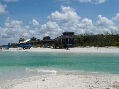 8. Enjoying a cabana on the white-sand beach…