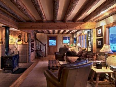 Rustic cabin interior with exposed beam ceiling